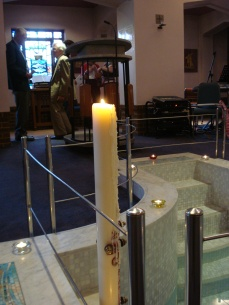 The Easter candle burns at Sacred Heart Church.
